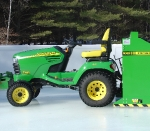 View of Model 100 behind John Deere tractor.