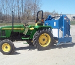 Zamboni Model 200 attached to a John Deere tractor.