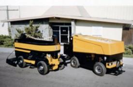 Machine No. 21 post-restoration and its contemporary cousin prepare for shipment to Boston.